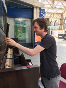 Me tuning the pianos at Sheffield Train Station.